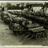 Army Service Corps wagons in a village square in Northern France