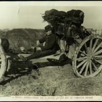 A French artilleryman makes coffee on his gun in Northern France