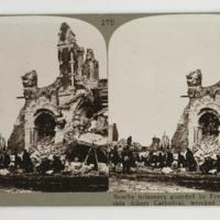 Bosche prisoners guarded by French troops beside Albert Cathedral, wrecked by shell fire