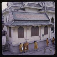 Monks in saffron robes at temple